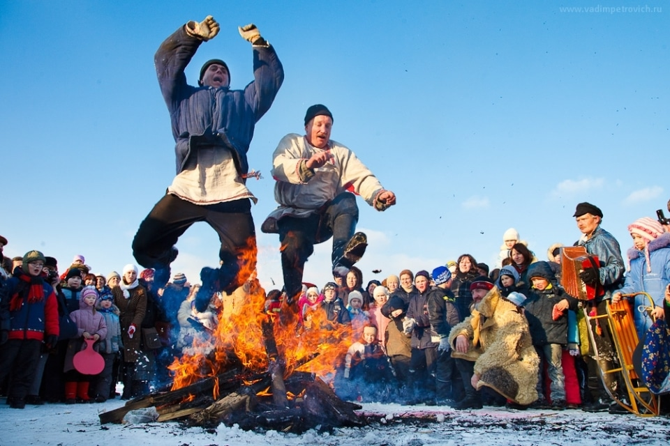 Jumping over a fire during the Maslenica Festival