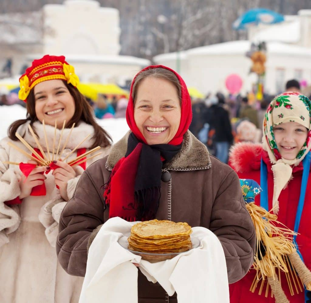 Maslenica Festival-Goers Carrying Staples of The Holiday - including blini (bleeni), or Russian crepes